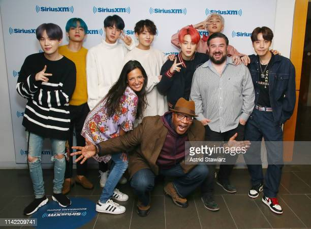 SiriusXM hosts Nicole Ryan Stanley T and Ryan Sampson pose with South Korean group BTS while visiting 'The Morning Mash Up' On SiriusXM Hits 1...
