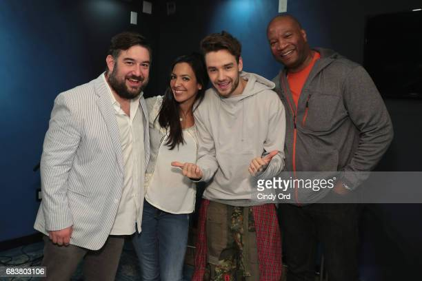 SiriusXM hosts Ryan Sampson Nicole Ryan and Stanley T pose for a photo with Liam Payne during his visit to The Morning Mash Up for a special...