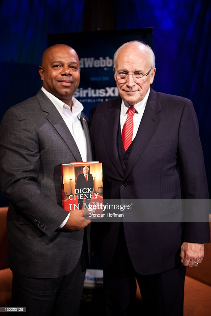 SiriusXM Patriot host David Webb (L) poses for a picture with Former Vice President Dick Cheney after an interview at SiriusXM studios on October 25, 2011 in Washington, DC. Cheney recently released his memoir, 'In My Time.'