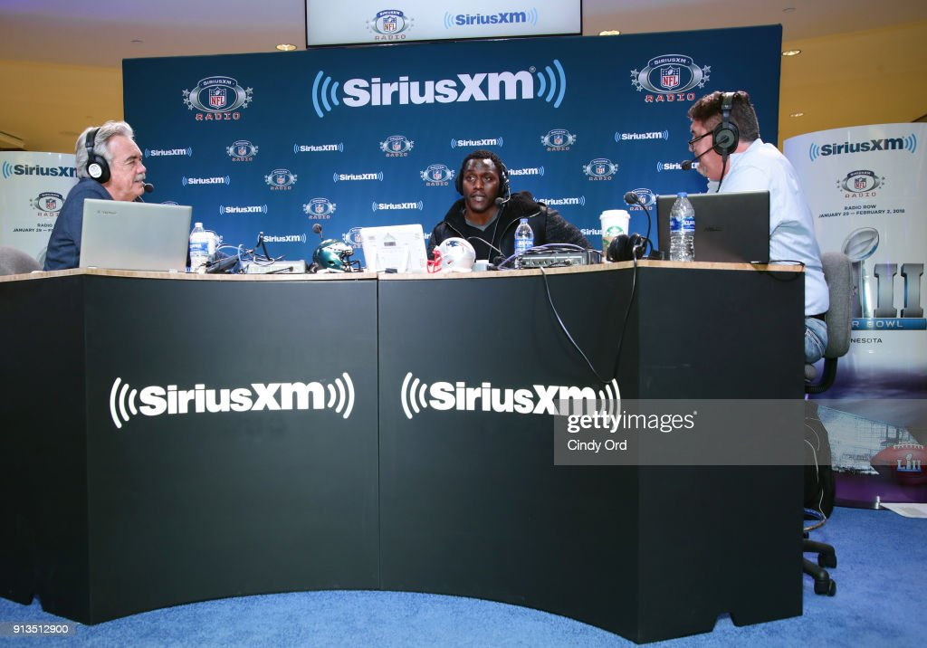 SiriusXM radio hosts Pat Kirwan (L) and Jim Miller (R) and former NFL player Takeo Spikes attend SiriusXM at Super Bowl LII Radio Row at the Mall of America on February 2, 2018 in Bloomington, Minnesota.