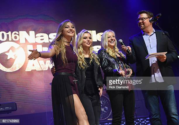 SiriusXM The Highway's Storme Warren presents Vocal Group of the Year Southern Halo accepts during the 2016 Nashville Universe Awards at Wildhorse...