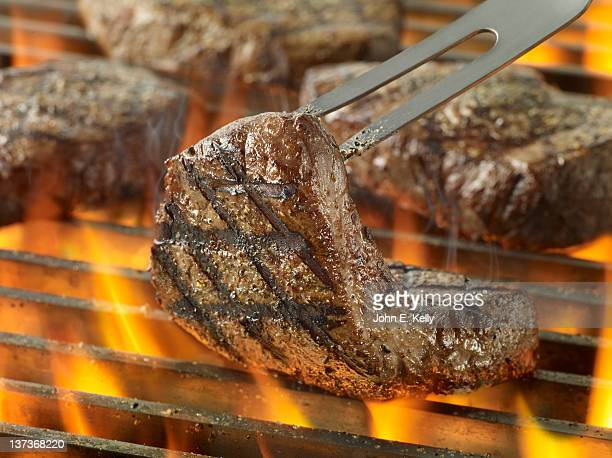 Sirloin Steak on Grill with Flames