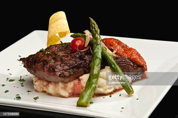 Sirloin steak with mashed potatoes and asparagus