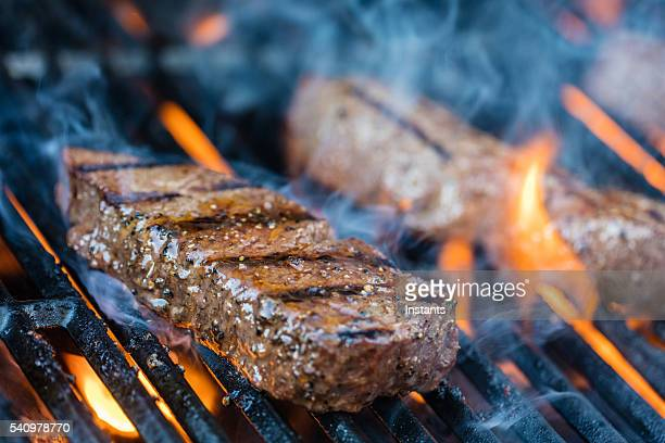 sirloin steaks on the bbq - meat stock pictures, royalty-free photos & images