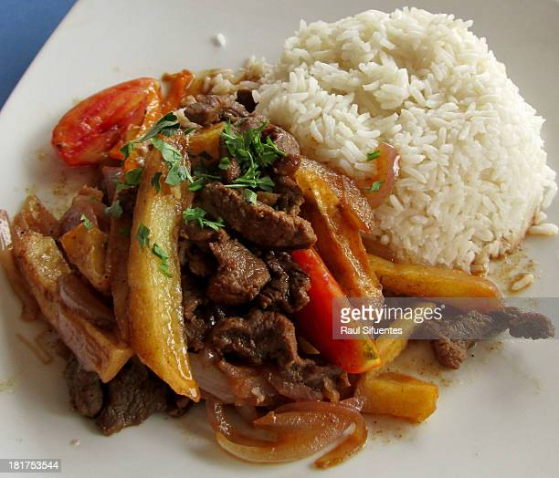 Sirloin with rice yuca and chopped onions at a Peruvian restaurant on September 22 2013 in Lima Peru