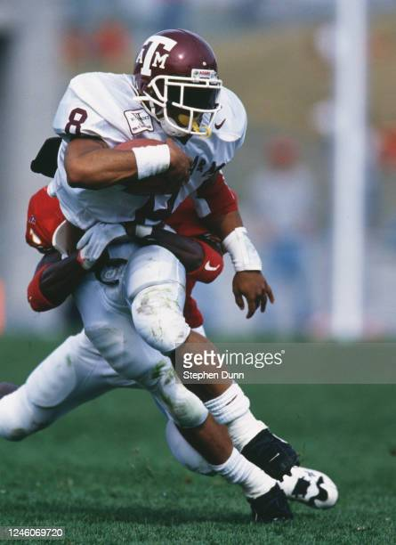 Sirr Parker, Runniing Back for the Texas A&M Aggies is tackled by Kevin Hudson, Defensive Back for the Iowa State Cyclones during their NCAA Big 12...
