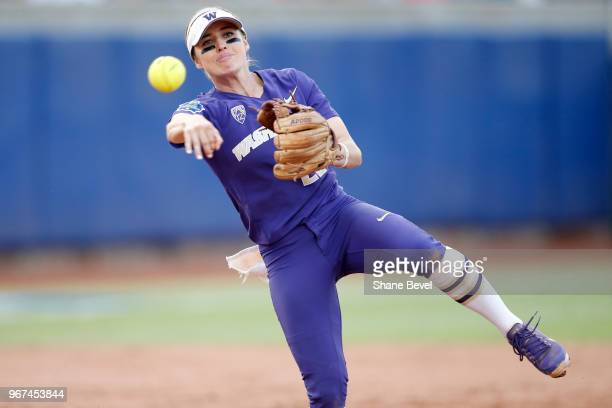 Sis Bates of the Washington Huskies makes a play at shortstop against the Florida State Seminoles during the Division I Women's Softball Championship...