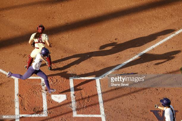 Sis Bates of the Washington Huskies scores against the Florida State Seminoles during the Division I Women's Softball Championship held at USA...