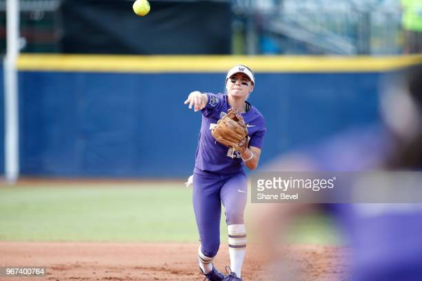 Sis Bates of the Washington Huskies throws out a batter against the Florida State Seminoles during the Division I Women's Softball Championship held...