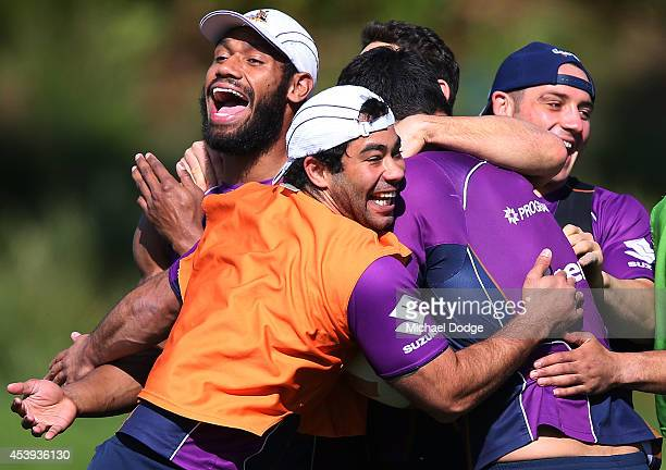Sisa Waqa Joel Romelo and Cooper Cronk react after a drill during a Melbourne Storm NRL training session at Gosch's Paddock on August 22 2014 in...