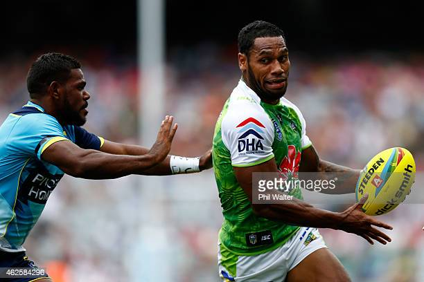 Sisa Waqa of the Raiders breaks a tackle during the match between the Titans and the Raiders in the 2015 Auckland Nines at Eden Park on February 1...