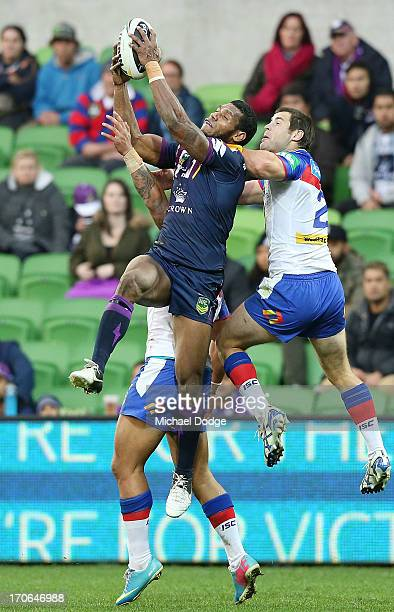 Sisa Waqa of the Storm catches a high ball in the dying stages against James McManus of the Knights the round 14 NRL match between the Melbourne...