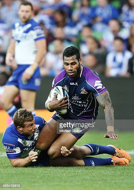 Sisa Waqa of the Storm is tackled during the NRL 2nd Elimination Final match between the Melbourne Storm and the Canterbury Bankstown Bulldogs at...