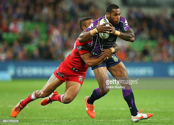 Sisa Waqa of the Storm is tackled during the round 6 NRL match between the Melbourne Storm and the St George Illawarra Dragons at AAMI Park on April...