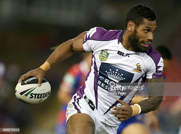 Sisa Waqa of the Storm makes a break for the try line during the round 22 NRL match between the Newcastle Knights and the Melbourne Storm at Hunter...