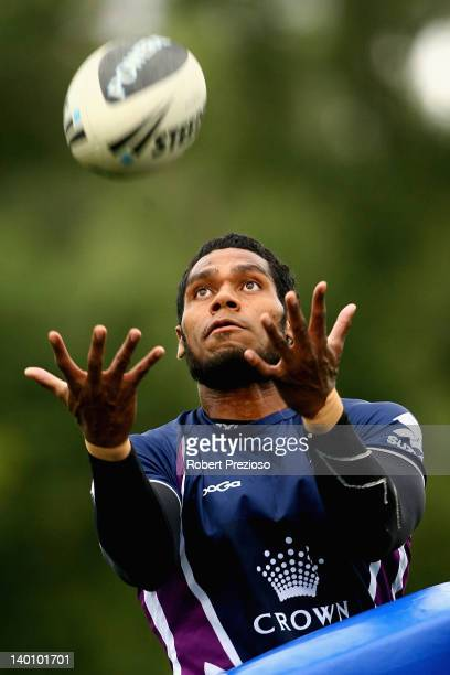 Sisa Waqa of the Storm takes the ball during a Melbourne Storm NRL training session at Gosch's Paddock on February 28 2012 in Melbourne Australia