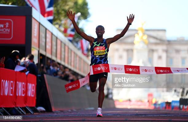 Sisay Lemma of Ethiopia celebrates winning the Men's Elite race during the 2021 Virgin Money London Marathon at Tower Bridge on October 03, 2021 in...