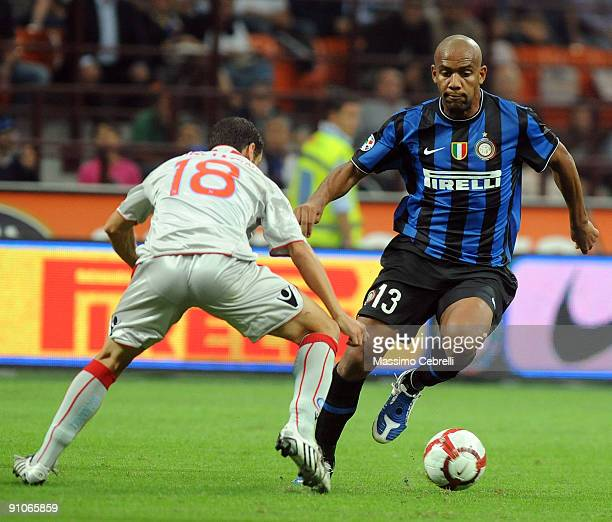 Sisenando Maicon Douglas of FC Inter Milan and Mariano Bogliacino of SSC Napoli compete for the ball during the Serie A match between FC Inter Milan...