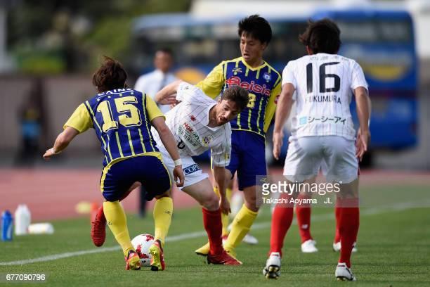 Sisinio of FC Gifu competes for the ball against Shohei Okada and Yuki Okaniwa of Thespa Kusatsu Gunma during the JLeague J2 match between Thespa...