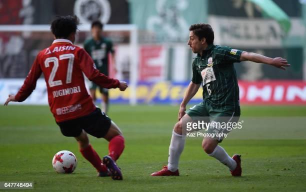 Sisinio of FC Gifu takes on Koki Sugimori of Nagoya Grampus during the J.League J2 match between Nagoya Grampus and FC Gifu at Toyota Stadium on...