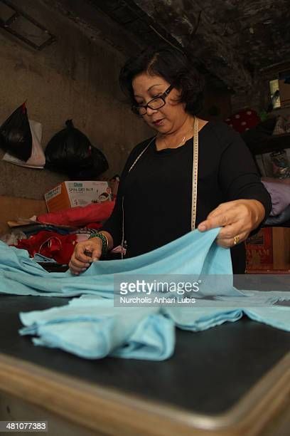Siska workshop owner and fashion designer boutique Doggy draws the pattern to the process of making clothes animals on March 28 2014 in Cimahi...