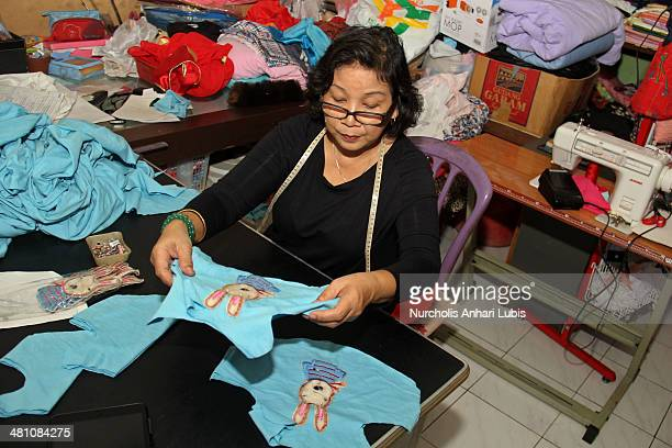 Siska workshop owner and fashion designer boutique Doggy once draws the pattern to the process of making clothes pets on March 28 2014 in Cimahi...