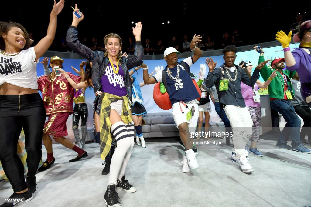 Sisqó (C) dances onstage with Just Dance 2018 during E3 2017 at Los Angeles Convention Center on June 15, 2017 in Los Angeles, California.