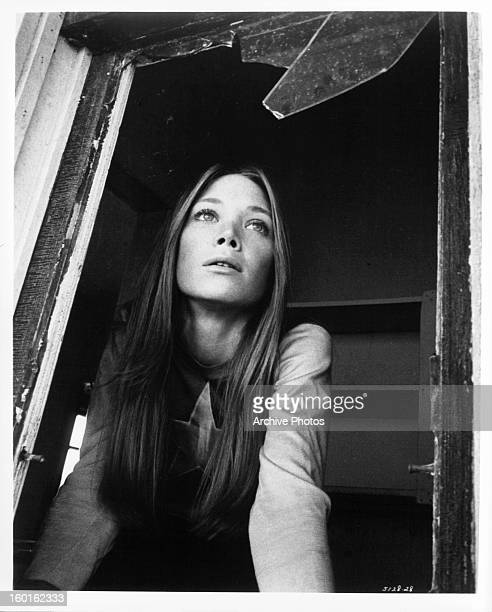 Sissy Spacek looking out shattered window in a scene from the film 'Prime Cut' 1972