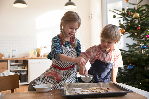 Sister and brother making cookies at christmas - gettyimageskorea