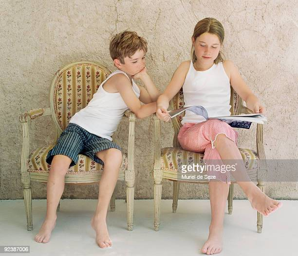 Sister and brother reading