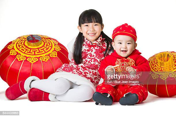 sister and brother with traditional lanterns - headwear stock pictures, royalty-free photos & images