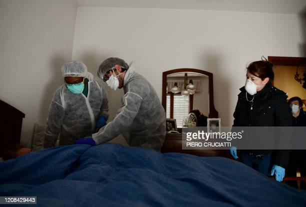 Sister Angel Bipendu and Simone Patane doctors part of the USCA special care unit of ATS Bergamo who performs home visits to patients infected or...