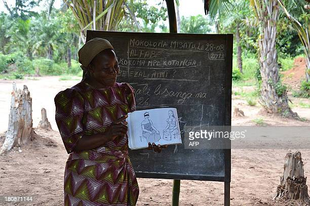 Sister Angelique Namaika stands next to a blackboard as she tutors a class at an internally displaced camp in Nanzawa in northeastern Democratic...