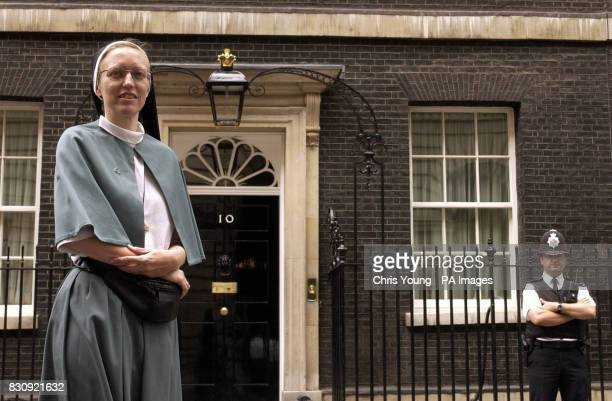 Sister Annaliese Brogden of the Community of the Sisters of the Church pauses outside No 10 Downing Street after members of Pax Christie an...