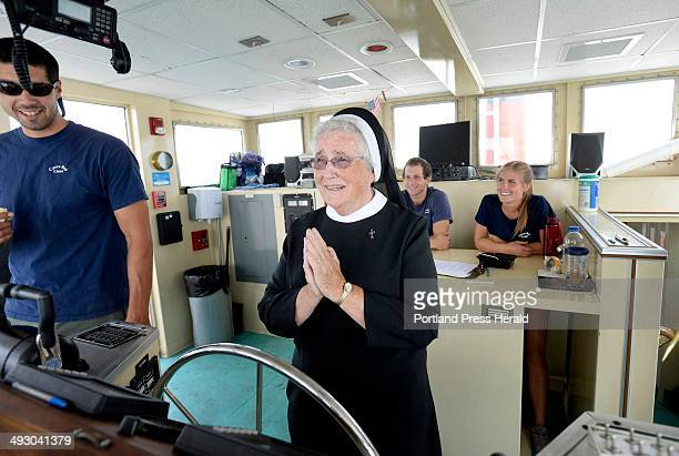 Sister Anne Marie Kiah of South Portland says a prayer before taking the helm of a Casco Bay Lines ferry while out on an outing with sisters...
