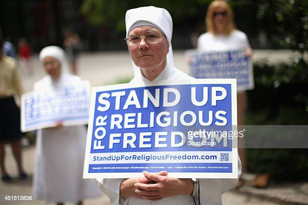 Sister Caroline attends a rally with other supporters of religious freedom to praise the Supreme Court's decision in the Hobby Lobby contraception...