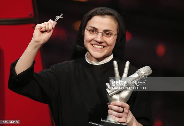 Sister Cristina Scuccia reacts after winning the Italian State RAI TV program's final The Voice of Italy in Milan on June 6 2014 The 25yearold nun...