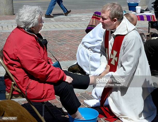 Sister Dale Jarvis with the Sisters of Mercy of Portland gets her feet washed by Rev Tim Higgins from St Ann's Episcopal Church in Windham during a...
