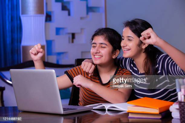 sister doing homework at home stock photo - teenage girls stock pictures, royalty-free photos & images