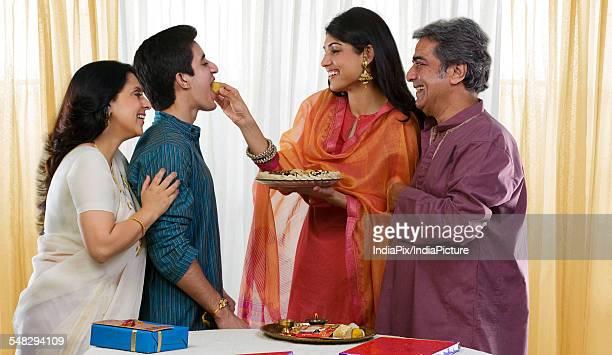 Sister feeding her brother during Rakhi