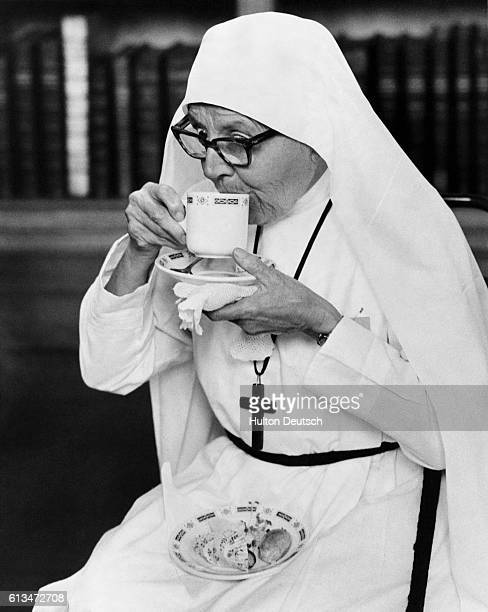 Sister Florence of the Oxford Mission in Calcutta sips a cup of tea after attending a meeting of some 600 missionaries with Dr Michael Ramsey the...