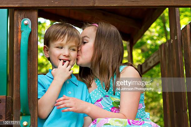 Sister giver her younger brother kiss