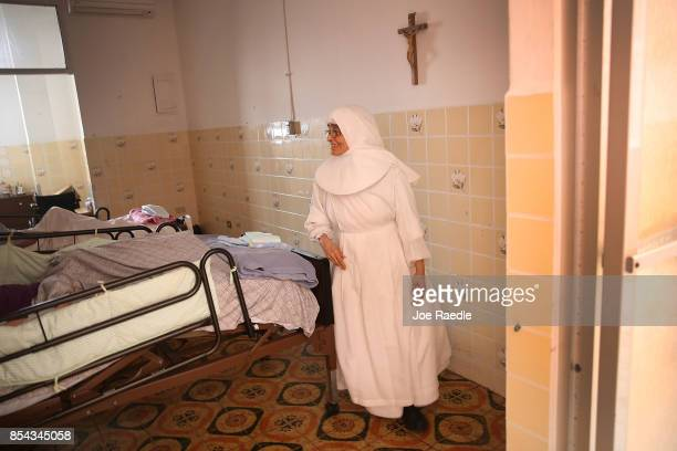 Sister Gloria Flores checks in on some frail patients at the Hermanitas de los Ancianos Desamparados facility which cares for the elderly as they...
