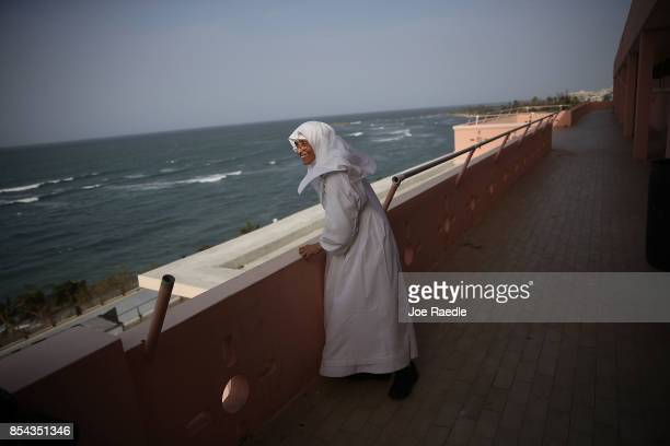 Sister Gloria Flores looks out off a balcony of the Hermanitas de los Ancianos Desamparados facility which cares for the elderly as they deal with...