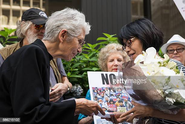 Sister Gwen from Pax Christi presents a letter to Miyako Taguchi whose parents survived the atomic explosion in Nagasaki speaks at the rally A...