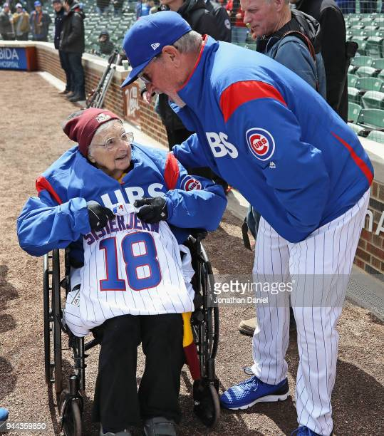 Sister Jean Delores Schmidt of Loyola University talks with manager Joe Maddon of the Chicago Cubs before the Opening Day home game between the Cubs...