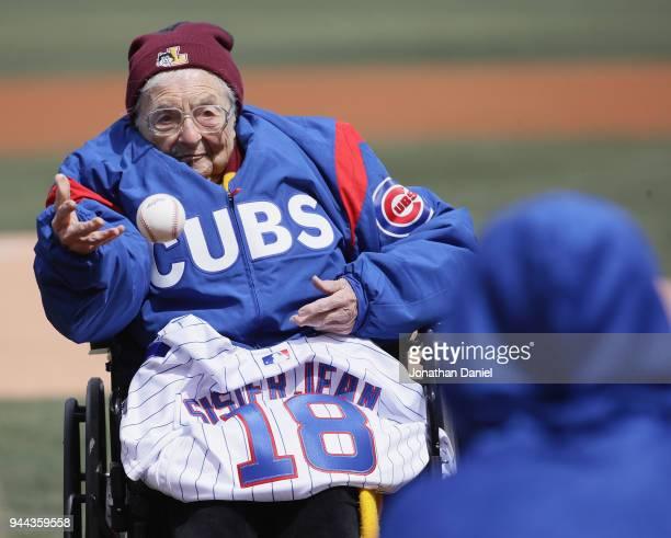Sister Jean Delores Schmidt of Loyola University tosses a ceremonial first pitch before the Opening Day home game between the Chicago Cubs and the...