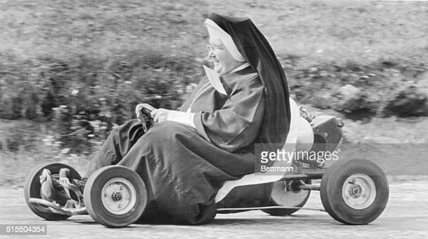 Sister John Bosco of St Sebastian School here breezes around the track in a gocart during an outing for the Catholic Nuns who teach in Akron's...