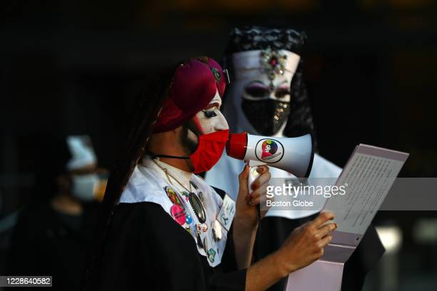 Sister Lida Christ, with The Boston Sisters of Perpetual Indulgence, reads from the vigil program during a vigil for Supreme Court Justice Ruth Bader...