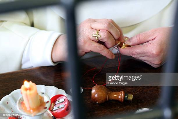 Sister Maria Angelica showes how to assemble a small reliquiary at the cloistered convent of St Mary of the Rosary on February 6 2014 in Vatican City...
